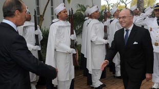 French Interior Minister Bernard Cazeneuve (R) with Moorocco's Mohamed Hassad on Saturday