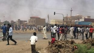 People take part in protests over fuel subsidy cuts in Khartoum, 25 September 2013