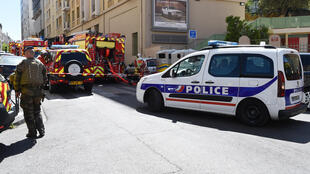 A French soldier, police and firefighters' vehicles are seen at the site of a police search at the home of one of the two men arrested in Marseille on April 18, 2017.