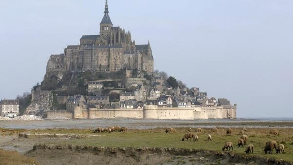 The Mont Saint-Michel 11th century abbey to be entirely surrounded by the English Channel following exceptionally high spring tides.