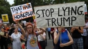 Demonstrators protest next to the specially erected fence surrounding the U.S. ambassador's residence, Winfield House, where U.S. President Donald Trump and the First Lady Melania Trump are staying, in London, Britain, July 12, 2018.