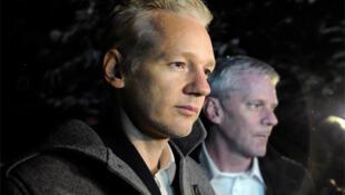 Assange speaks to the media outside Ellingham Hall, Suffolk