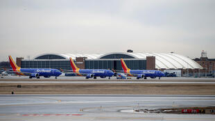 Southwest Airlines Co. Boeing 737 MAX 8 aircraft sit next to the maintenance area after landing at Midway International Airport in Chicago, Illinois, U.S., March 13, 2019.