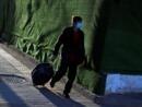 Coronavirus: la Chine ferme ses frontières, les étrangers se disent stigmatisés