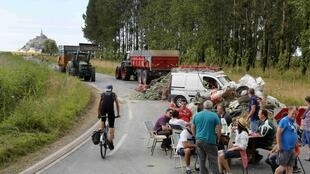 Farmers block a road in Normandy on 21 July 2015