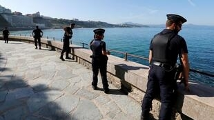 Police patrol the security perimeter of the G7 summit in Biarritz, France, 23 August 2019.