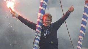 French skipper François Gabart celebrates his victory in the Vendée Globe sailing race