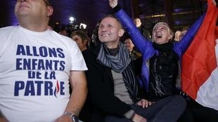 Front National supporters cheer the result in the northern town of Hénin-Beaumont, Sunday 6 December 2015
