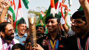 The symbol of the Commonwealth games, the Queen's Baton, is paraded around New Delhi.