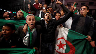 Protesters on the streets of Algiers following President Bouteflika's resignation