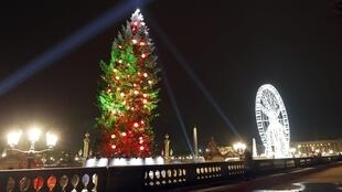 A 32-metre high Christmas tree has been installed by the now-traditional big wheel on Paris's Place de la Concorde