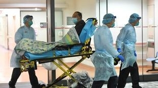 Medical staff transfer a patient of a suspected case of a new coronavirus at the Prince of Wales Hospital in Hong Kong, China January 22, 2020.