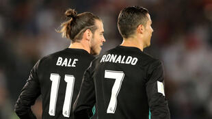 Gareth Bale and Cristiano Ronaldo both scored in Real Madrid's victory over Al Jazira at the Club World Cup in Abu dhabi.