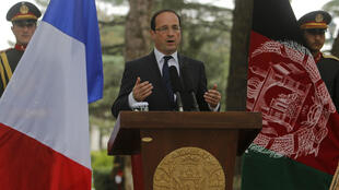 French President Francois Hollande speaks during a news conference in Kabul 25 May