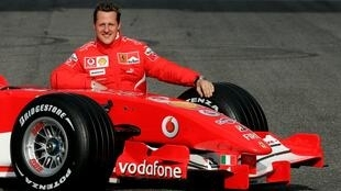 Michael Schumacher of Germany poses with the new Ferrari Formula One race car 248 F1 during the official presentation at the Mugello racetrack in Scarperia, central Italy, in this January 24, 2006 file photo.