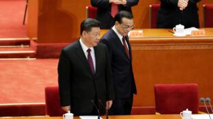 去年12月18日,中国国家主席习近平与中国国务院总理李克强在纪念改革40周年大会上。
