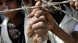 Des réfugiés érythréens dans un camp de migrants au Soudan.