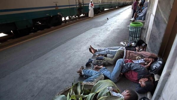 Migrants rest on the platform of Ventimiglia railway station, near the Italian-French border, 18 June 2015.