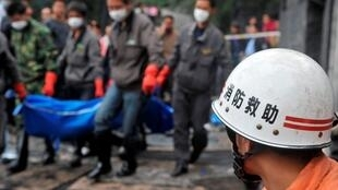 Rescuers bring out a miner's body after a previous accident in Anshun in May