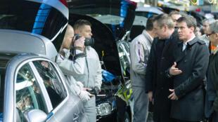 Prime Minister Manuel Valls visits a PSA car factory in Sochaux