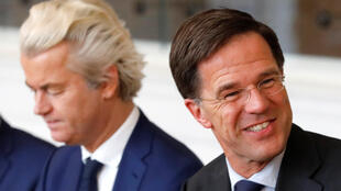 Dutch Prime Minister Mark Rutte (right) of the VVD Liberal party and Dutch far-right politician Geert Wilders of the PVV Party take part in a meeting at the Dutch Parliament after the general election in The Hague.