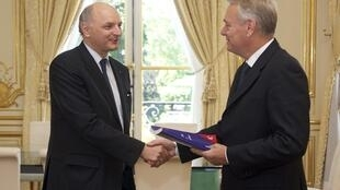 French PM Jean-Marc Ayrault receives the audit from Cours des Comptes head Didier Migaud