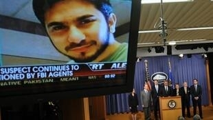 An image of Faisal Shahzad on a tv screen during a briefing on the investigation