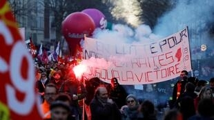 "Protesters hold a banner reading ""Fight for our retirements until victory"" during a demonstration against the French government's plan to overhaul the country's retirement system in Paris, on February 6, 2020."