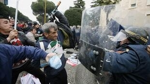 Supporters of the opposition Socialist Party clash with police during an anti-government rally in Tirana