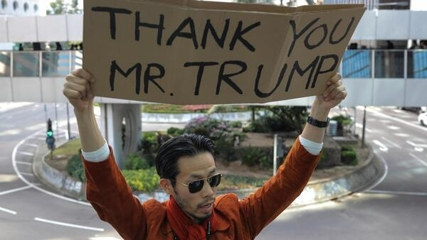A man holds a placard during a lunchtime protest in Hong Kong.