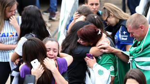 Chapecoense fans in front of the Arena Conda stadium in Chapeco after the crash