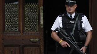 An British police officer, armed in case of attacks