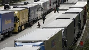 Drivers with their lorries on the M20 motorway from London to the Channel Tunnel terminal at Ashford and the Ferry Terminal at Dover