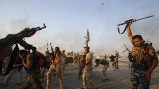 Shia militia fighters combating IS in Iraq