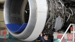 Workers carry out maintenance on an Airbus