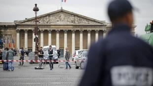 French police secure the Champs Elysees after a car drove through barriers nearby set up for the final stage of the Tour de France in Paris, 26 July 2015