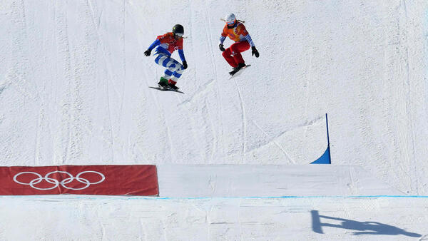 Michela Moioli of Italy and Julia Pereira de Sousa Mabileau of France compete in the snowboarding