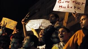 Protesters carry placards during demonstrations in Cairo