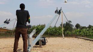 A drone pilot monitors a flight using a smartphone in Rwanda's capital, Kigali.