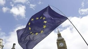 The European flag in front of the British parliament