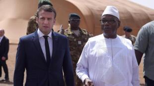 French president Emmanuel Macron is met in Gao by his Malian counterpart, Ibrahim Boubacar Keïta on May 19, 2017.