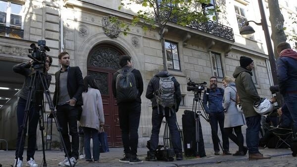 Journalists outside the building where Kim Kardashian was staying