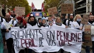 Health workers at a demonstration in Paris, 14 November 2019. The government hopes the newest measures will calm the protests.