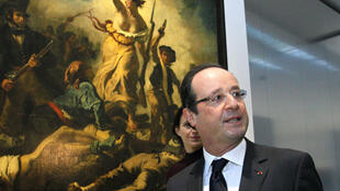President François Hollande in front of Liberty leading the people at the inauguration of Le Louvre-Lens Museum