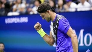 Grigor Dimitrov recorded his first victory over Roger Federer on his eighth attempt.