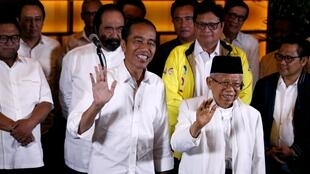 La fórmula del éxito: el saliente mandatario saliente Joko Widodo y su vicepresidente Ma'ruf Amin, líder supremo de la principal organización musulmana de Indonesia