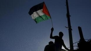 A Palestinian flag during the first leg of the Palestine Cup final soccer match between Gaza Strip's Shejaia and Hebron's Al-Ahly at al-Yarmouk stadium in Gaza City, 6 August 2015.