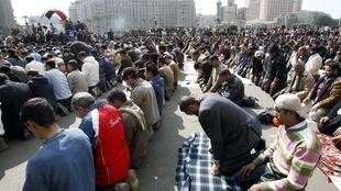 Anti-government protesters pray in Cairo's Tahrir Square, 31 January 2011
