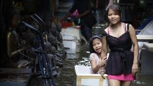 A flooded amulet market in an ancient part of Bangkok near Chao Praya river