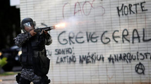 A policeman at a protest against Brazil President Michel Temer in  Brasilia on 24 May 2017.